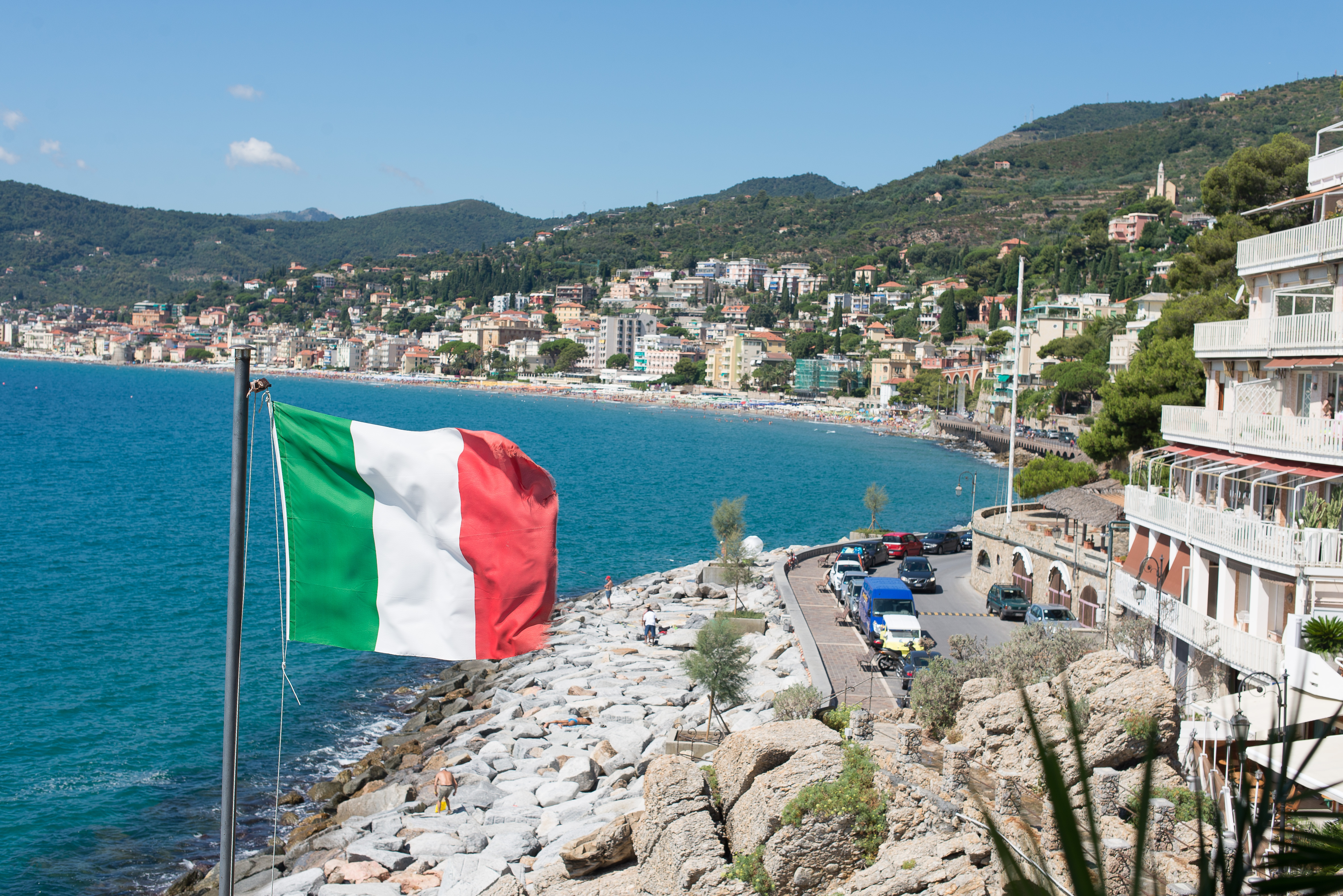 Big world   italy flag on a background of the beach in alassio  italy 062836